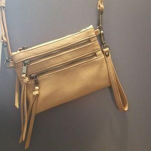 Cute tan purse with detachable matching key chain.